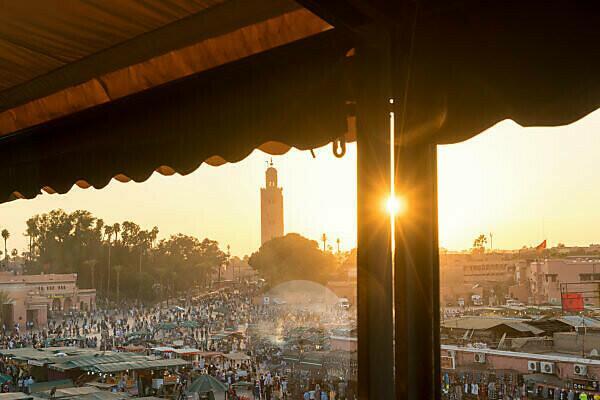 Morocco, Marrakech, Medina, Place Djemaa El Fna, Terrace view in backlight, Koutoubia Mosque