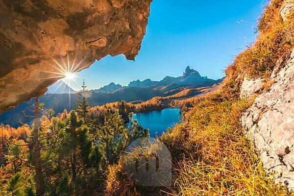 Federa lake in autumn framed in a rock window, Croda da Lago, Dolomites, Cortina d Ampezzo, Belluno, Veneto, Italy