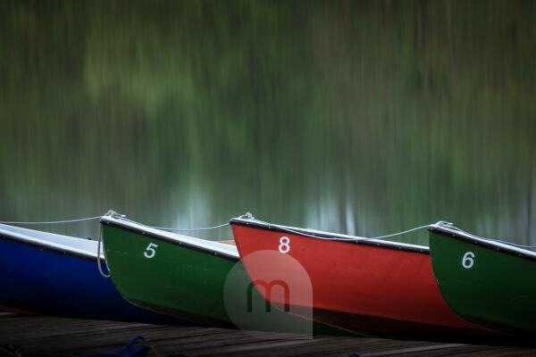 Oar boats on a bridge in the Maschsee in Hannover, Germany