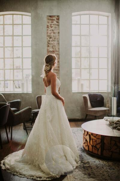 Bride looks thoughtfully out of the window