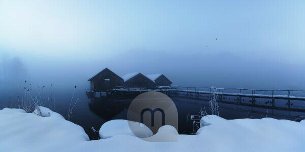 Winter fog over fisherman huts at the lake, Kochelsee, Free State of Bavaria, Germany