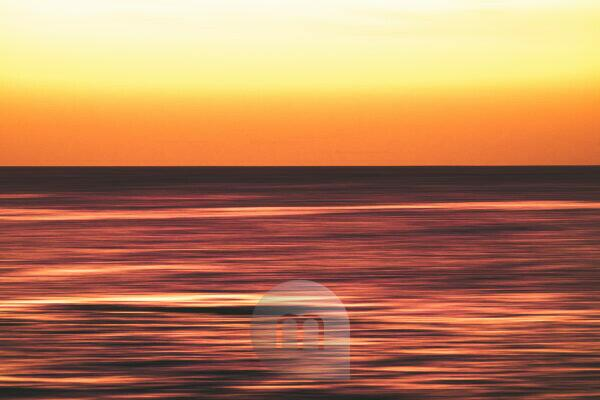 Artistic view of ocean sea water in long exposure in motion - background and coulours for nature concept - outdoors holiday vacation