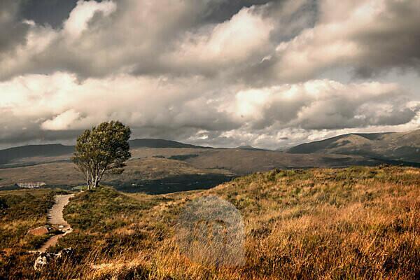 Dramatic sky over characteristic Scottish highland landscape