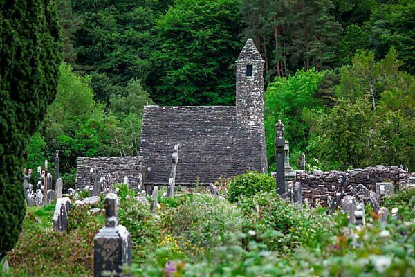 Old stone church in the monastery of Glendalough in Ireland