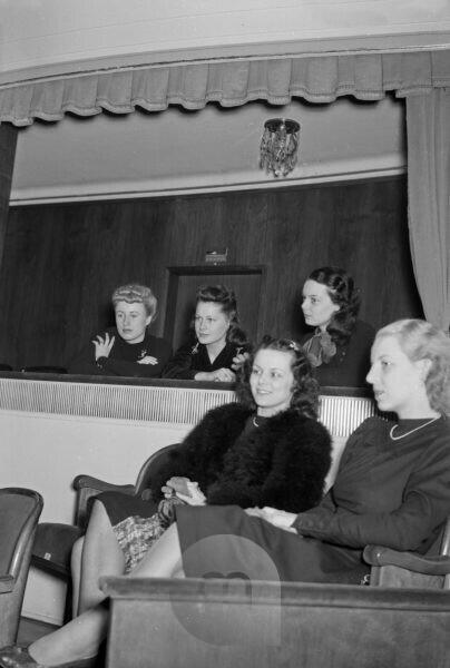Audience at a movie premiere in the cinema, Germany 1940s.