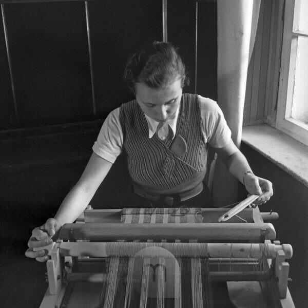 Apprenticeship to a weaver and spinner at the weaving school at Sommerfeld, Germany 1930s.