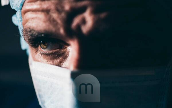 Close-up of a focused surgeon