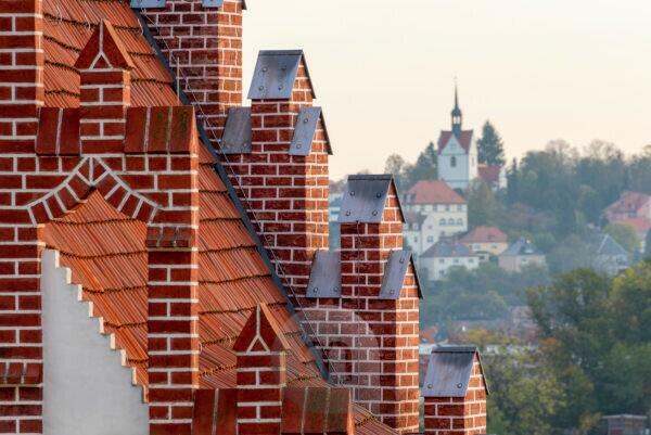 Germany, Saxony, Meissen, above the rooftops of the city, red roof of a brick house.