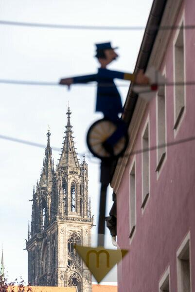 Germany, Saxony, Meissen, view of the Meissen Cathedral with figure of a high wire artist.