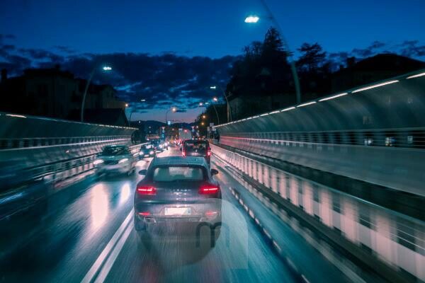 evening traffic of cars in the city, alpini bridge, belluno, veneto, italy