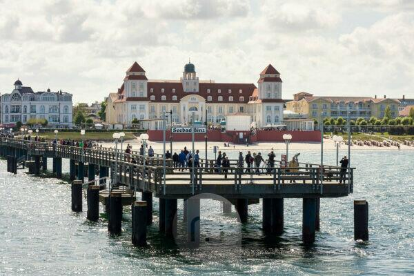 Baltic Sea, seaside resort Binz, spa house and pier with steamer landing, tourists waiting