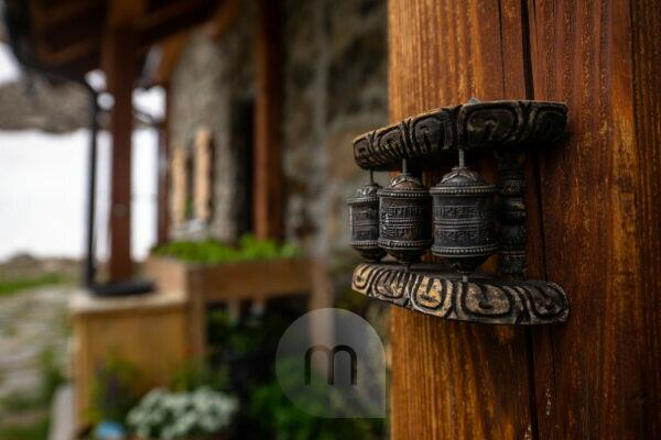 Europe, Austria, Tyrol, Ötztal Alps, Pitztal, Plangeross, Buddhist prayer wheels on the terrace of the Kaunergrathütte