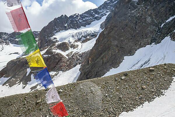 Europe, Austria, Tyrol, Ötztal Alps, Pitztal, Plangeross, Buddhist prayer flag on the Kaunergrathütte