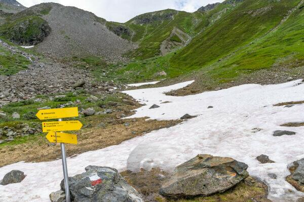 Europe, Austria, Tyrol, Ötztal Alps, Pitztal, Plangeross, signpost in front of an old snow field on the way to Karlesegg