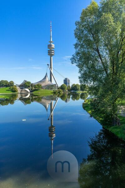 Europe, Germany, Bavaria, Munich, Olympiapark Munich, Olympic Tower reflected in the Olympic Lake