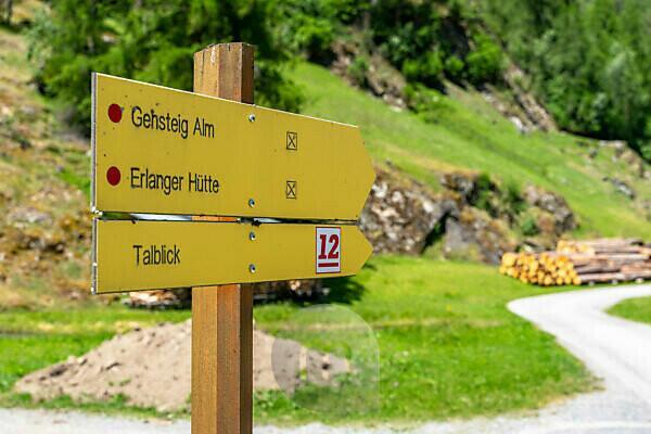 Europe, Austria, Tyrol, Ötztal Alps, Ötztal, signpost of the Ötztaler Urweg on a forest road near Umhausen