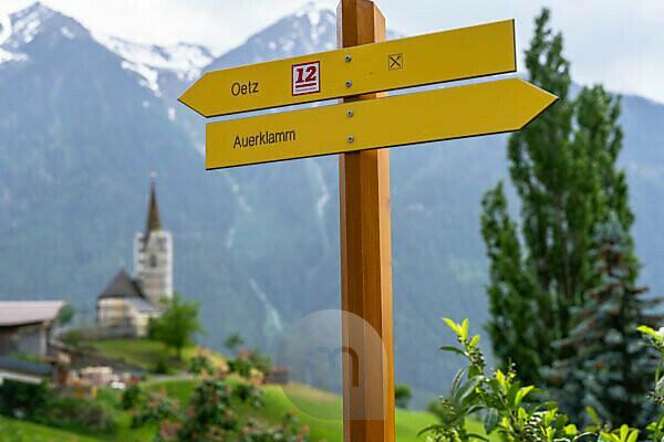 Europe, Austria, Tyrol, Ötztal Alps, Ötztal, signpost of the Ötztaler Urweg towards Oetz in front of the chapel near Oetzerau