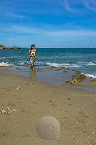 America, Caribbean, Greater Antilles, Dominican Republic, Cabarete, woman strolls along the beach