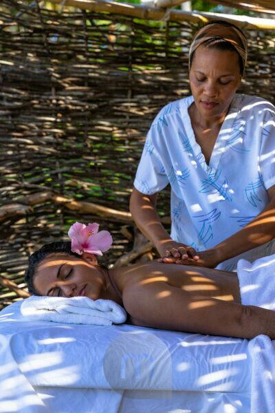 America, Caribbean, Greater Antilles, Dominican Republic, Cabarete, woman gets a massage on the beach at the Natura Cabana Boutique Hotel & Spa
