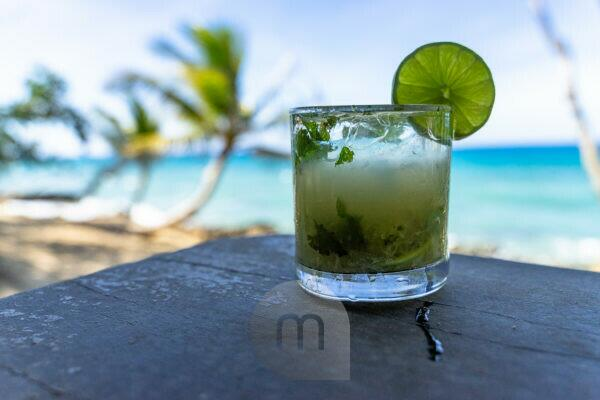 America, Caribbean, Greater Antilles, Dominican Republic, Cabarete, Mojito in front of the beach at the Natura Cabana Boutique Hotel & Spa