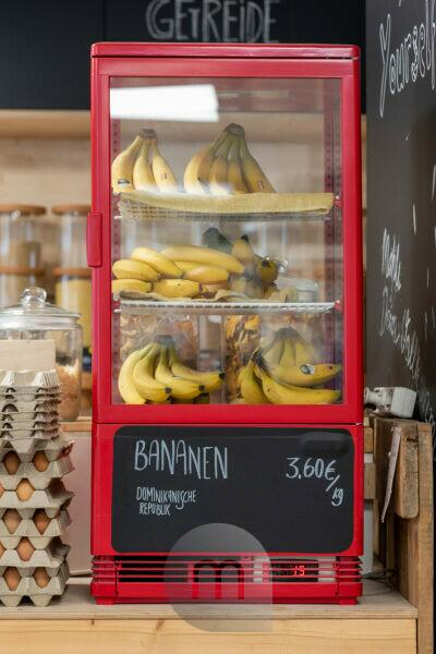 Bananas are in a refrigerator. Detail from an unwrapped shop.